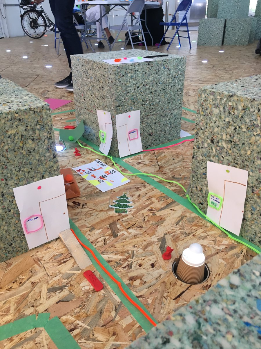 The prototype of a pedestrian focused neighborhood built by group Side Thoughts using foam blocks and construction paper